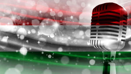 Microphone on a background of a blurry flag Hungary close-up, a design concept for your layout with a good place for text and images.