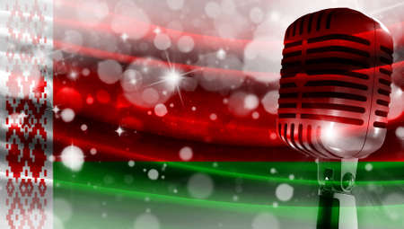 Microphone on a background of a blurry flag Belarus close-up, a design concept for your layout with a good place for text and images.