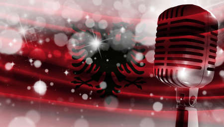 Microphone on a background of a blurry flag Albania close-up, a design concept for your layout with a good place for text and images.