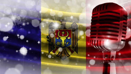 Microphone on a background of a blurry flag Moldova close-up, a design concept for your layout with a good place for text and images.