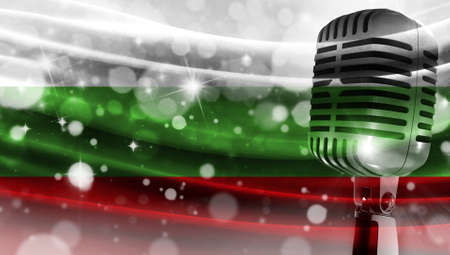 Microphone on a background of a blurry flag Bulgaria close-up, a design concept for your layout with a good place for text and images.