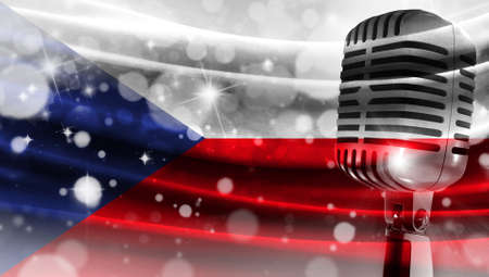 Microphone on a background of a blurry flag Czech Republic close-up, a design concept for your layout with a good place for text and images.