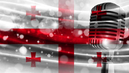 Microphone on a background of a blurry flag Georgia close-up, a design concept for your layout with a good place for text and images.