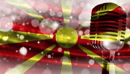Microphone on a background of a blurry flag Macedonia close-up, a design concept for your layout with a good place for text and images.