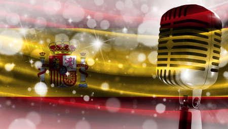 Microphone on a background of a blurry flag Spain close-up, a design concept for your layout with a good place for text and images.