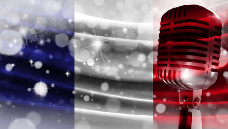 Microphone on a background of a blurry flag France close-up, a design concept for your layout with a good place for text and images.