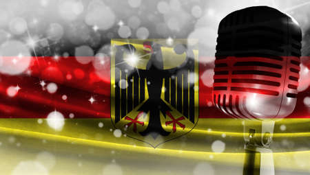 Microphone on a background of a blurry flag Germany close-up, a design concept for your layout with a good place for text and images.