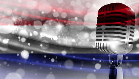 Microphone on a background of a blurry flag Netherlands close-up, a design concept for your layout with a good place for text and images.