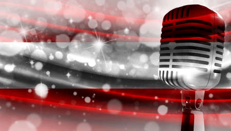 Microphone on a background of a blurry flag Austria close-up, a design concept for your layout with a good place for text and images.