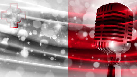 Microphone on a background of a blurry flag malta close-up, a design concept for your layout with a good place for text and images.