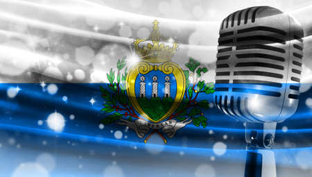 Microphone on a background of a blurry flag San marino close-up, a design concept for your layout with a good place for text and images.