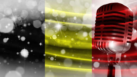 Microphone on a background of a blurry flag Belgium close-up, a design concept for your layout with a good place for text and images.