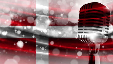 Microphone on a background of a blurry flag Denmark close-up, a design concept for your layout with a good place for text and images.
