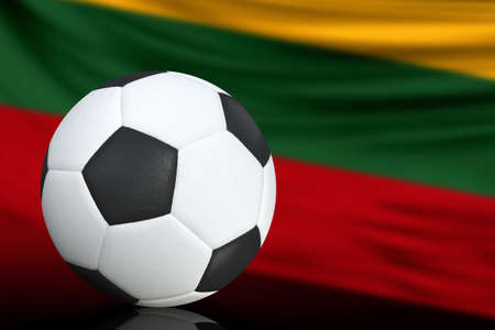 Soccer black and white ball close up, in the background a blurred flag of Lithuania. The image takes place for your text.