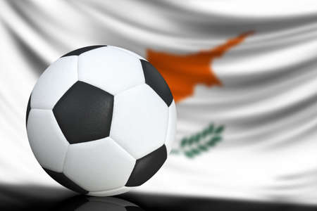 Soccer black and white ball close up, in the background a blurred flag of Cyprus. The image takes place for your text.