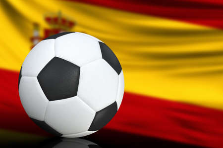 Soccer black and white ball close up, in the background a blurred flag of Spain. The image takes place for your text.