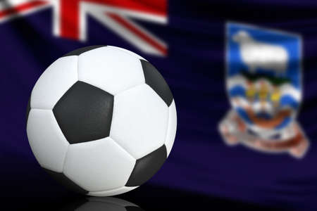 Soccer black and white ball close up, in the background a blurred flag of Falkland Islands. The image takes place for your text. Imagens