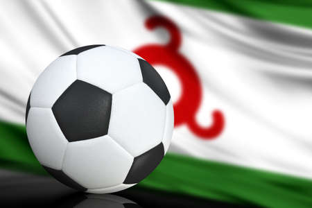 Soccer black and white ball close up, in the background a blurred flag of Ingushetia. The image takes place for your text.