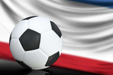 Soccer black and white ball close up, in the background a blurred flag of Crimea. The image takes place for your text.