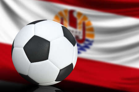 Soccer black and white ball close up, in the background a blurred flag of French Polynesia. The image takes place for your text.