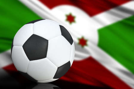 Soccer black and white ball close up, in the background a blurred flag of Burundi. The image takes place for your text. Imagens