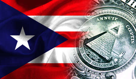 Flag of Puerto Rico on a fabric with an American dollar close-up.