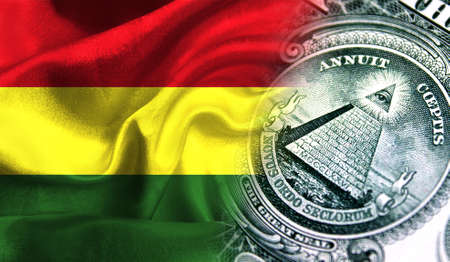 Flag of Bolivia on a fabric with an American dollar close-up.