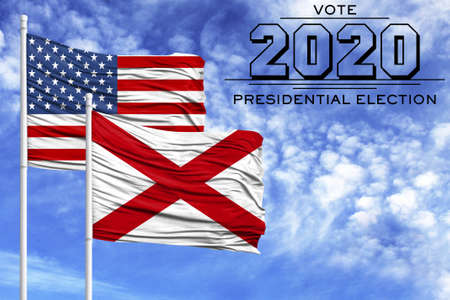US elections in November 2020, against a blue sky, two flagpoles with the flag of America and the State of Alabama.