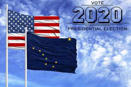 US elections in November 2020, against a blue sky, two flagpoles with the flag of America and the State of Alaska.