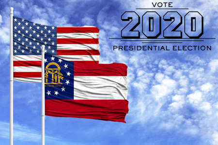 US elections in November 2020, against a blue sky, two flagpoles with the flag of America and the State of Georgia.