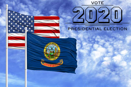 US elections in November 2020, against a blue sky, two flagpoles with the flag of America and the State of Idaho.