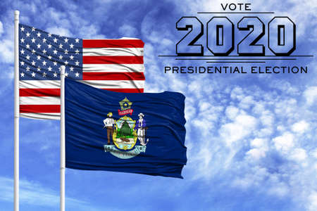 US elections in November 2020, against a blue sky, two flagpoles with the flag of America and the State of Maine.