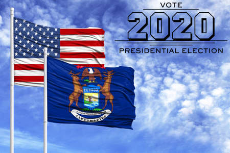 US elections in November 2020, against a blue sky, two flagpoles with the flag of America and the State of Michigan. 写真素材