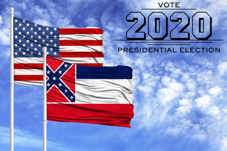 US elections in November 2020, against a blue sky, two flagpoles with the flag of America and the State of Mississippi.