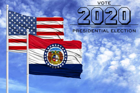 US elections in November 2020, against a blue sky, two flagpoles with the flag of America and the State of Missouri.