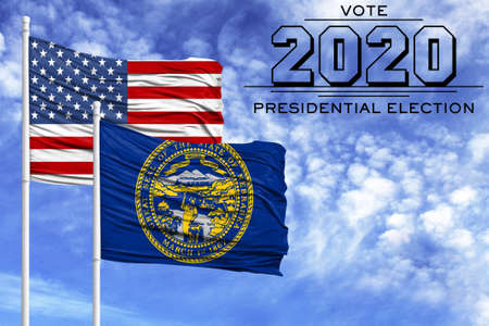 US elections in November 2020, against a blue sky, two flagpoles with the flag of America and the State of Nebraska.