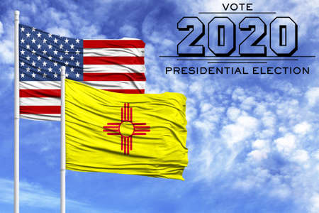 US elections in November 2020, against a blue sky, two flagpoles with the flag of America and the State of New Mexico.