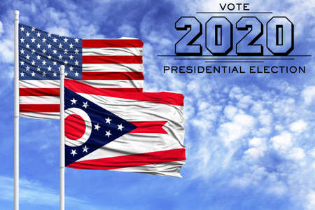 US elections in November 2020, against a blue sky, two flagpoles with the flag of America and the State of Ohio. 写真素材
