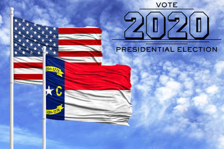 US elections in November 2020, against a blue sky, two flagpoles with the flag of America and the State of North Carolina.