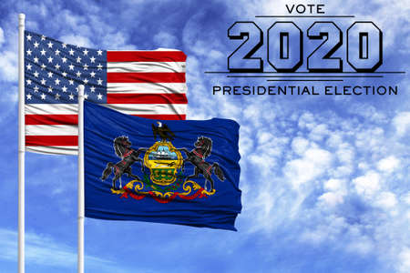 US elections in November 2020, against a blue sky, two flagpoles with the flag of America and the State of Pennsylvania.