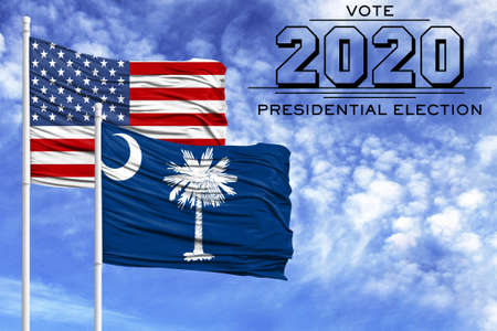 US elections in November 2020, against a blue sky, two flagpoles with the flag of America and the State of South Carolina.