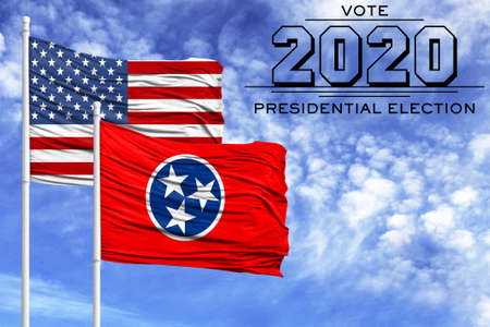 US elections in November 2020, against a blue sky, two flagpoles with the flag of America and the State of Tennessee.