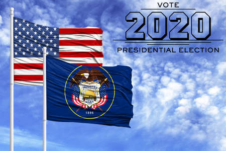 US elections in November 2020, against a blue sky, two flagpoles with the flag of America and the State of Utah.