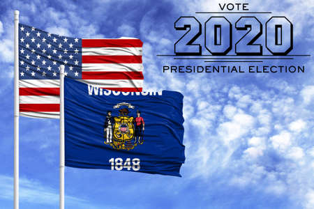 US elections in November 2020, against a blue sky, two flagpoles with the flag of America and the State of Wisconsin.
