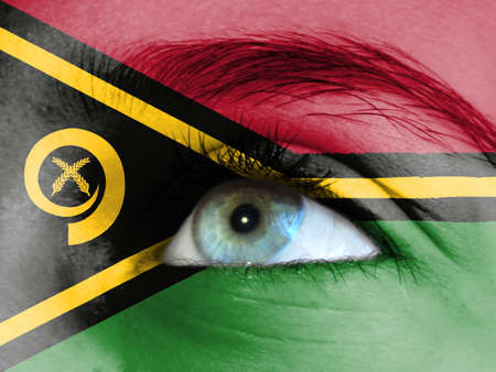 Close up view of a young girl. The flag of Vanuatu is painted on the girl face.