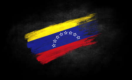 smear of paint in the form of the flag of Venezuela close-up on a black background