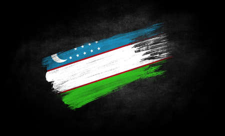 smear of paint in the form of the flag of Uzbekistan close-up on a black background