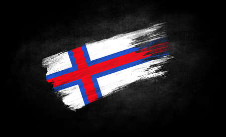 smear of paint in the form of the flag of Faroe Islands close-up on a black background