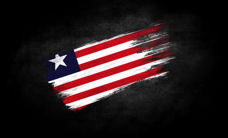 smear of paint in the form of the flag of Liberia close-up on a black background