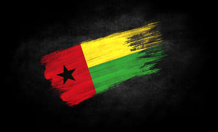 smear of paint in the form of the flag of Guinea Bissau close-up on a black background